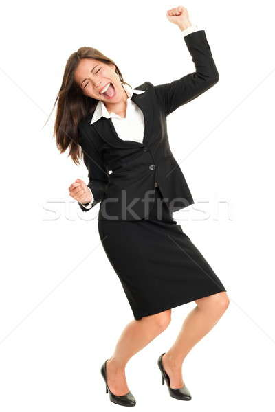 1568356_stock-photo-celebrating-business-person-dancing-happy